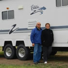 Alex and Irene Onody posing in front of their 2001 Citation Supreme RV.