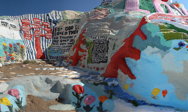 Colourful man-made mountain of clay painted with primitive religious symbols