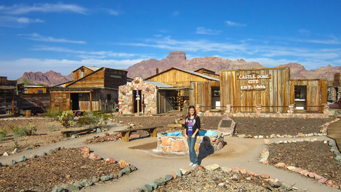 Haley Jones stands in front of the historic buildings of the old mining boom town of Castle Dome.