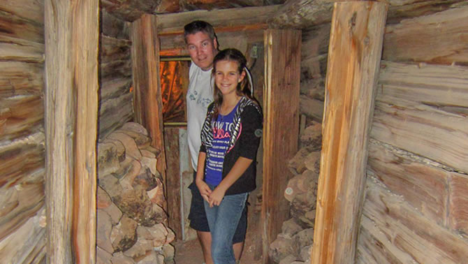 Haley and Glyn Jones explore an old mine tunnel of Castle Dome Mines Museum.
