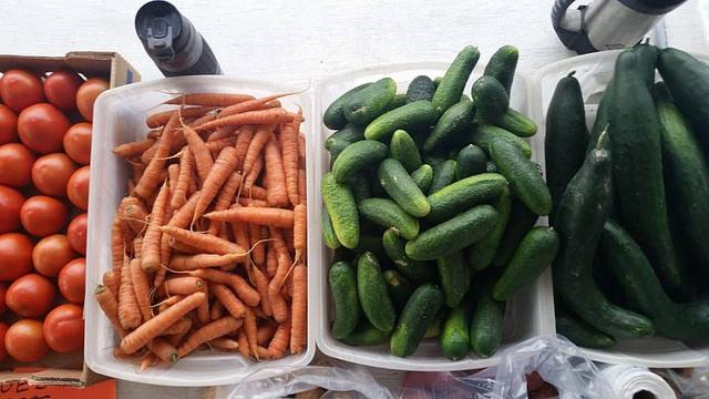 Fresh carrots, cucumbers, zuchini and tomatoes on display at the Dawson Creek Farmers' Market.