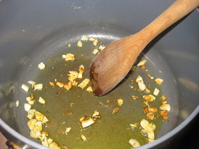 Step one: sauté  the garlic over med-high heat until the cloves are golden brown.