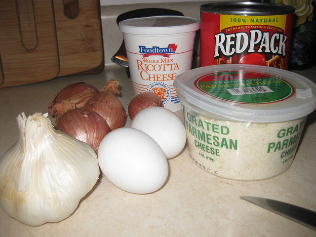 The ingredients needed to make Chads' meatballs; eggs, garlic, onions, ricotta cheese, parmesan cheese and tomato sauce.