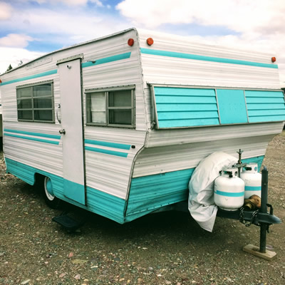 1960 Aristocrat trailer, painted aqua blue and white.