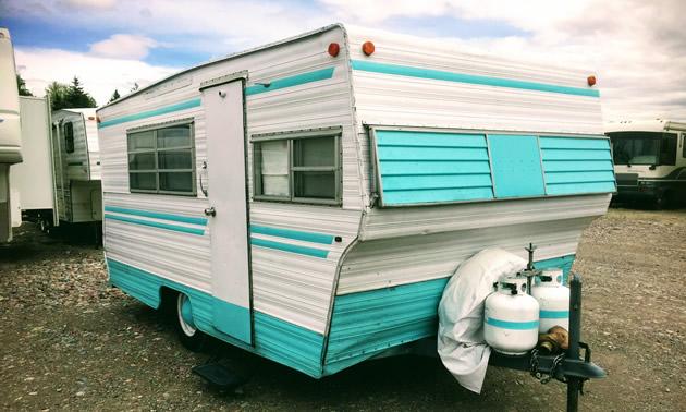 1960 Aristocrat trailer, painted aqua blue and white.