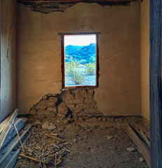 Looking out the window of one of the ruined miners' cottages