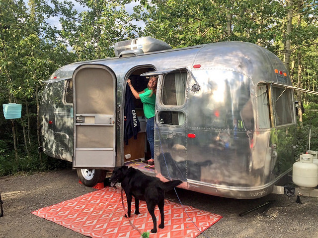 Anne Bovon is in the doorway of the couple's vintage airstream.