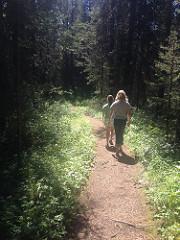 Two people walking along the Boulton Creek trail.
