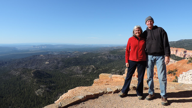 Kevin and Ruth Read standing on the top of an outcropping.