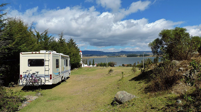 A photo of Sherman, the Read's motorhome overlooking a cliff above the ocean.