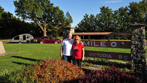 Oetter and Sommerfeld standing in front of  Mile Zero in Victoria, B.C.
