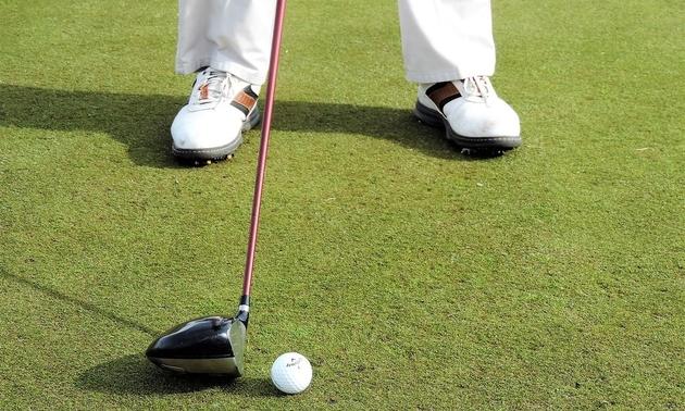 Shot of a golfer making a putt