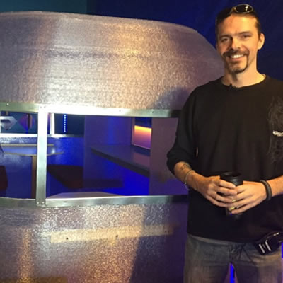 In this CTV News photo, Randy Janes poses in front of the world's first 3D-printed camper. He is the owner of Wave of the Future 3D and co-owner of Create Cafe based in Saskatoon, Sask.