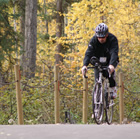 Cyclist enjoying the Community Trail in Fort Nelson, BC