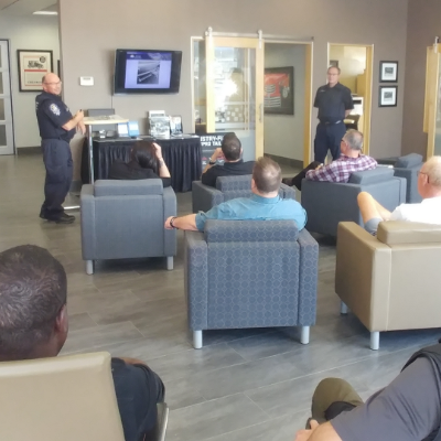 A room full of people listen to a presentation put on by the Ministry of Transportation's Ernie Krause and Douglas Archibald at Northstar GM in Cranbrook, B.C.
