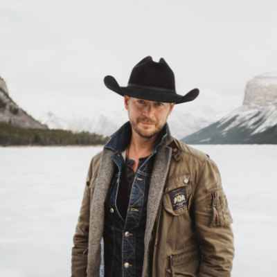 Paul Brandt poses in the mountains in winter