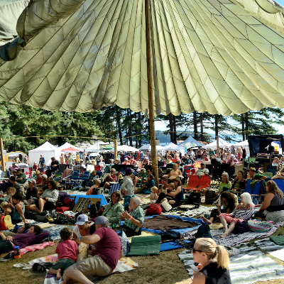 A unique cargo parachute sun/rain shade keeps the audience comfortable at the Sunshine Music Festival in Powell River, B.C.