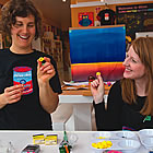 two female artists playing with some paints at 4Cats in Nelson, BC