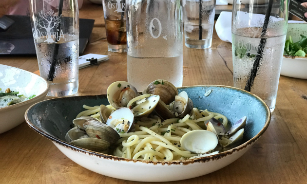 A plate full of oysters is on a table.