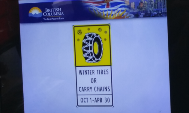 A sign with a picture of a winter tire and the dates Oct. 1 to Apr. 30 inscribed underneath.
