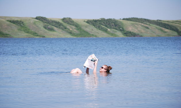 A woman floats in Little Manitou Lake