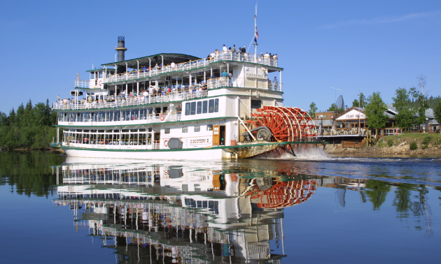 A riverboat sits on the water