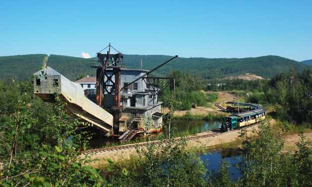 The Tanana Valley Railroad train stops beside Gold Dredge 8 as part of the tour.
