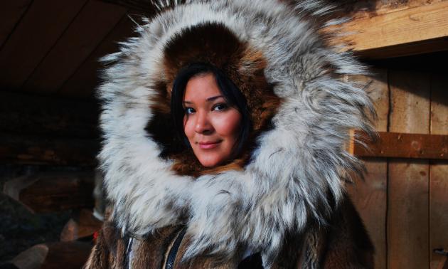 A Native Alaskan smiles for a photo