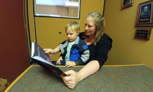 Michelle Forbes, author of Viking Lullaby, reads her book to her son, Jack.