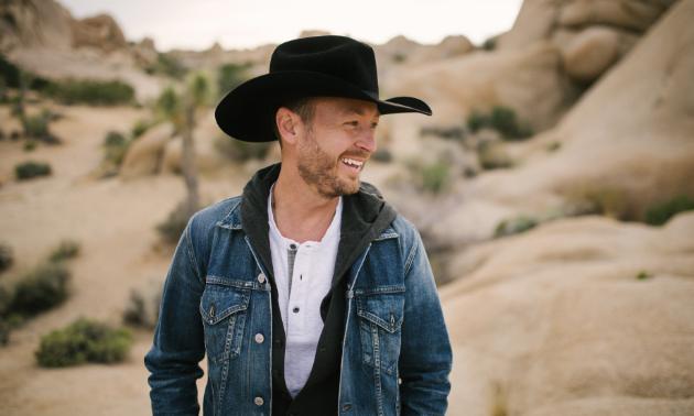 Paul Brandt smiles in the desert