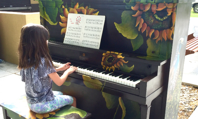 A child plays a piano