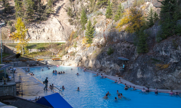 The world-famous Radium Hot Springs mineral pools are surrounded by natural rock walls.