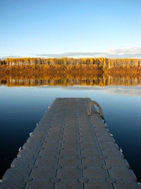 Picture of a wharf going out over a lake.