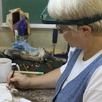 Kathy Phoenix carving a spotted sandpiper decoy.