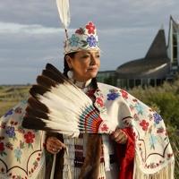 Native women in full costume.
