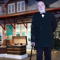 Rev. Leonard L. Gaetz (costumed interpreter) in front of the Red Deer Museum + Art Gallery train station.