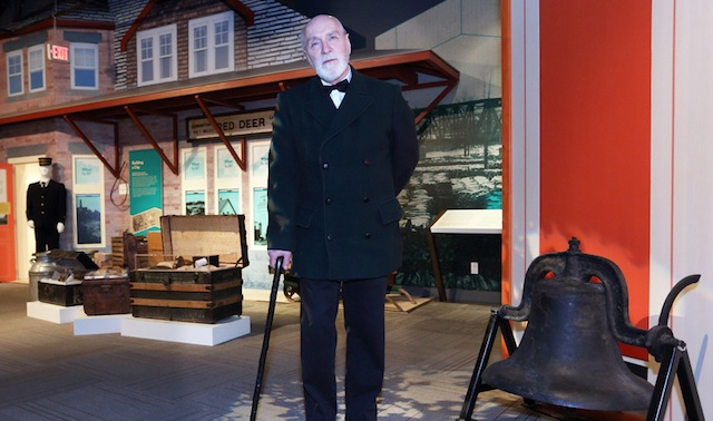Rev. Leonard L. Gaetz (costumed interpreter) in front of the Red Deer Museum + Art Gallery train station.