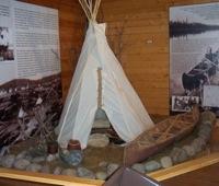 A display of a native tipee and birchbark canoe.