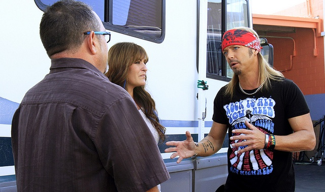 Bret Michaels talking to a couple in front of their RV.