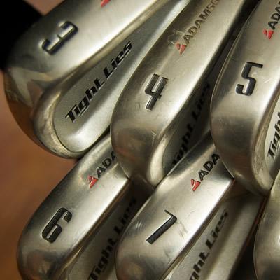 A beginner's set of Adams Tight Lie golf clubs