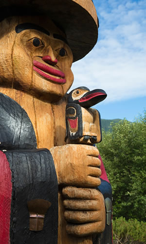 Shown is a large totem pole.