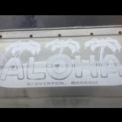 Close-up view of the Aloha Trailer company logo.