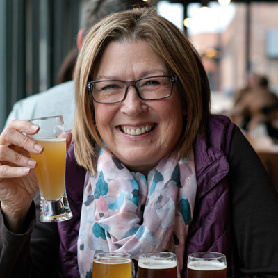 Kathy, my flight partner of decades, takes off with a wheat beer.
