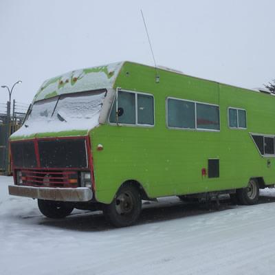 Large motorhome painted green.
