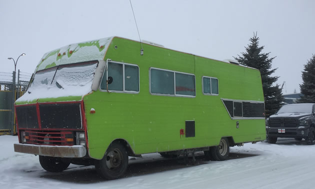 Large motorhome painted green.
