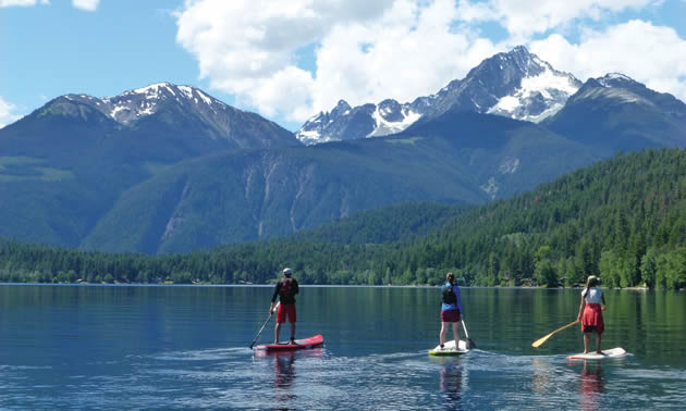 Boaters and paddle boarders alike enjoy the scenic lakes that surround Lillooet.