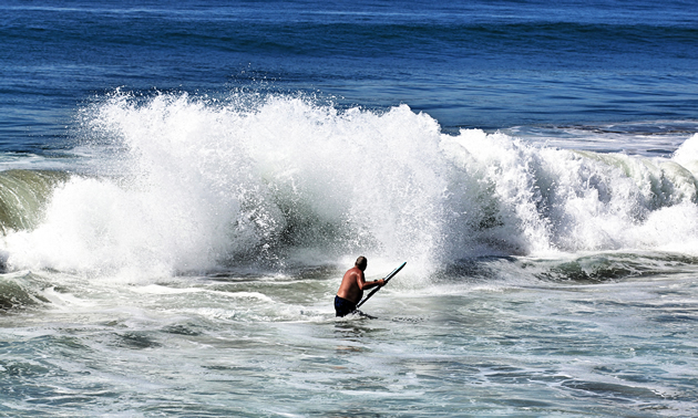 Dan Goy takes to the surf with his boogie board at Todos Santos.