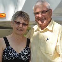 Smiling senior couple beside their RV