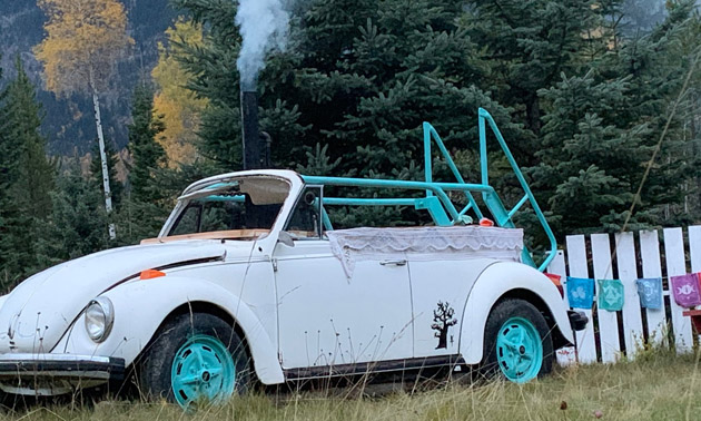 White VW Beetle with hot tub in it.