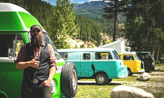 Jeremiah Woods standing in front of row of VW vans.
